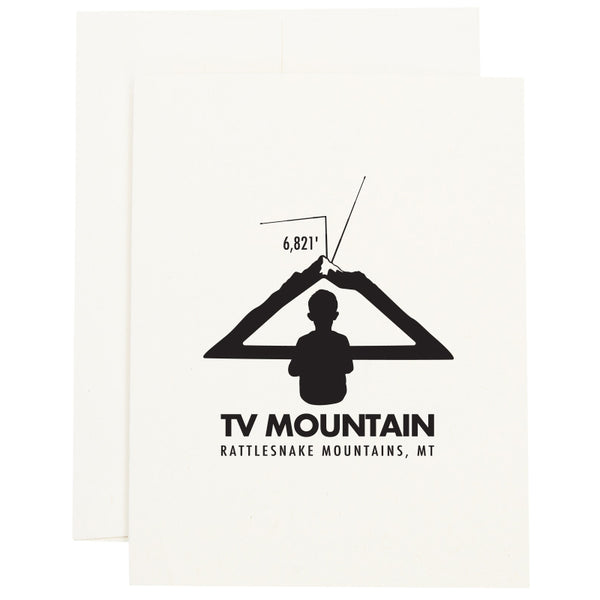 Image of a boy looking at a mountain as if it is a television to represent TV Mountain in Missoula, MT on a greeting card.