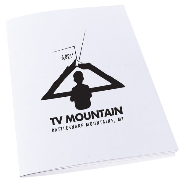 Image of a boy looking at a mountain as if it is a television to represent TV Mountain in Missoula, MT on a notebook.