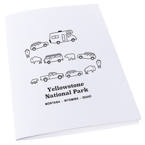 Image of a traffic jam at Yellowstone National Park in Montana, Wyoming, and Idaho with cars, campers, bears, and bison on a notebook.