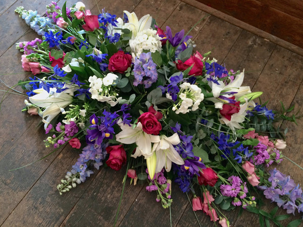 Pink, purple and white coffin spray