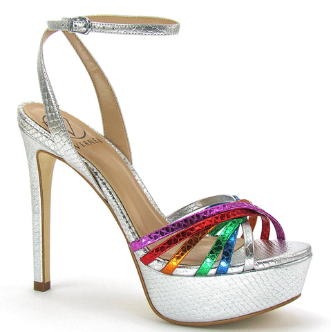 A platform sandal with a stiletto heel, covered in metallic silver snake skin and a metallic, multi-colored, snake skin print criss-crossing each other on the toe strap. In New Orleans at Shoe Be Do.
