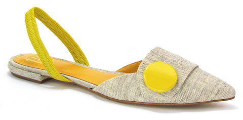 A pointed toe, natural-colored, flat allows the circular, yellow accent on the toe and yellow on the slingback strap. In New Orleans at Shoe Be Do.