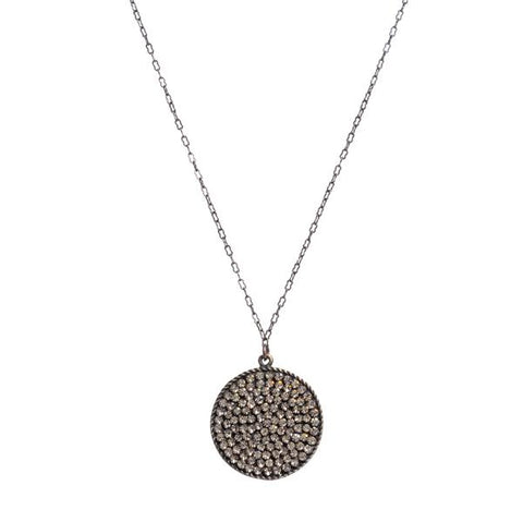 "Rebel round disc pave necklace. Antique brass finish with black diamond crystals. Lobster clasp closure. 16"" chain. Handmade in New York."