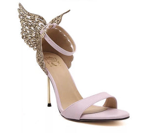 "A pink stiletto with a cutout, scalloped 3D angel wing detail extends from backstay.  4"" super skinny metallic heel. Thin strap bands open toe. Thin adjustable ankle strap. Padded leather insole. At Shoe Be Do in New Orleans,la."
