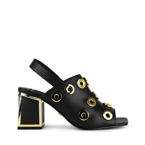 A Kat Maconie mid heel sandal with a low block heel. It has embellished cut-outs and ultra soft leather at Shoe Be Do in New Orleans,la.
