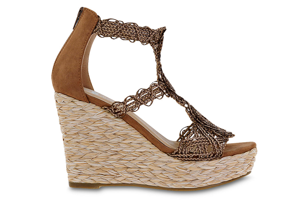 Featuring an intricate weaved design, resembling blueprints from man-made canals in a jute wrapped wedge sole. In New Orleans at Shoe Be Do.