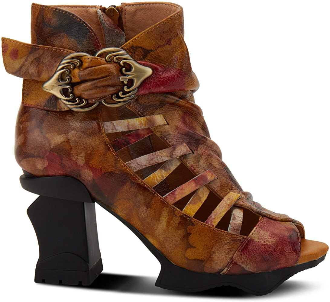 A Spring Step, French inspired, hand-crafted leather mid heel featuring asymmetrical leather weaving design and decorative Victorian-style antiqued metal buckle. At Shoe Be Do in New Orleans,la