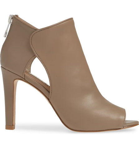 A Louise et Cie, oyster colored, open-toe bootie, mid stiletto heel with side cut outs to amplify the modern appeal. At Shoe Be Do in New Orleans,la.