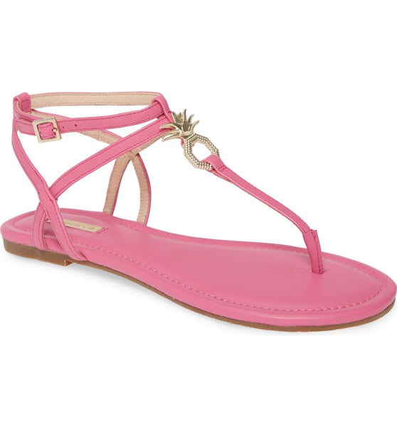 In a vibrant flamingo pink, garnished with an octagon, gold pineapple, you will be summer ready in this Louise Et Cie thong sandal at Shoe Be Do in New Orleans,la.