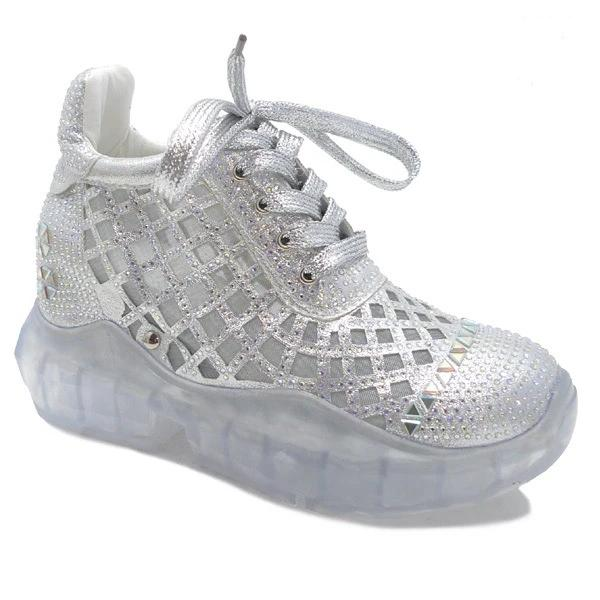Blinding to the human eye, will anyone be able to bask in how fabulous look in these platform, lace-up sneakers, featuring cutouts, embellished in rhinestones. In New Orleans in Shoe Be Do.