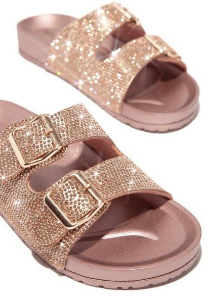 A dual-buckle strap Birkenstock style slide drowned in rhinestones. In New Orleans at Nola Foot Candy.