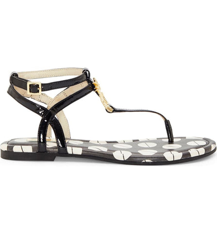 In a bold, black and print, garnished with an octagon, gold pineapple, you will be summer ready in this Louise Et Cie thong sandal.