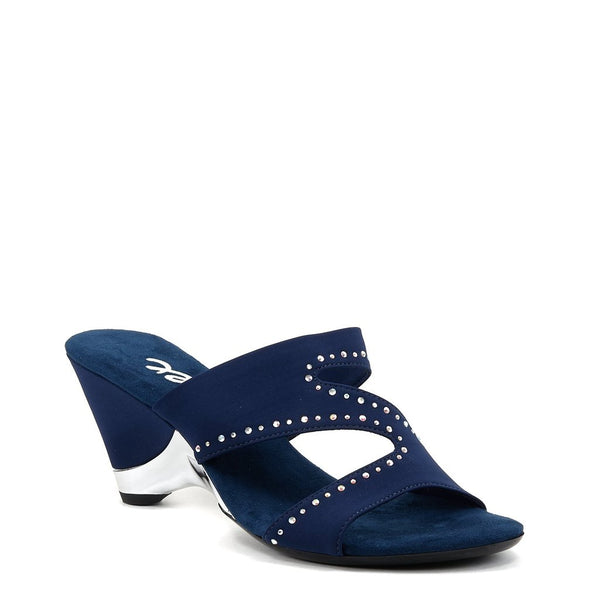An easy slip-on blue mule with a soft elastic upper and iridescent rhinestone embellishments and a cushioned foot bed. At Shoe Be Do in New Orleans, la.
