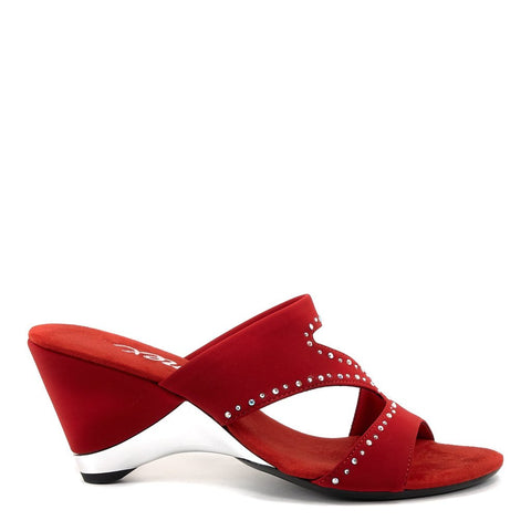 An easy slip-on red mule with a soft elastic upper and iridescent rhinestone embellishments and a cushioned foot bed. At Shoe Be Do in New Orleans, la.