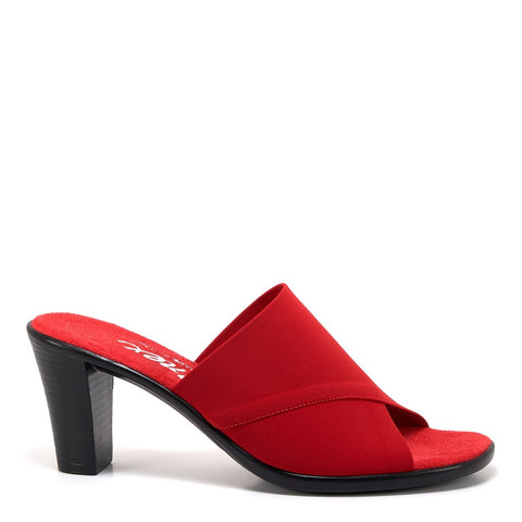 A fashionable, clean, easy slip-on mid height red mule with a elastic fabric upper and a black heel. At Shoe Be Do in New Orleans,la.