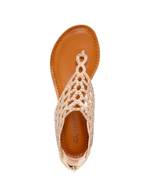 A chic thong sandal, featuring intricate cut outs embellished in rhinestones with a zip closure. In New Orleans at Shoe Be Do.