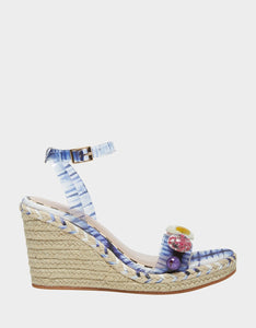 These beautiful platform sandals have a wedge heel and an clear adjustable ankle strap printed in blue tie dye and a lucite upper encompassing little spring time flowers. At Shoe Be Do in New Orleans,la.