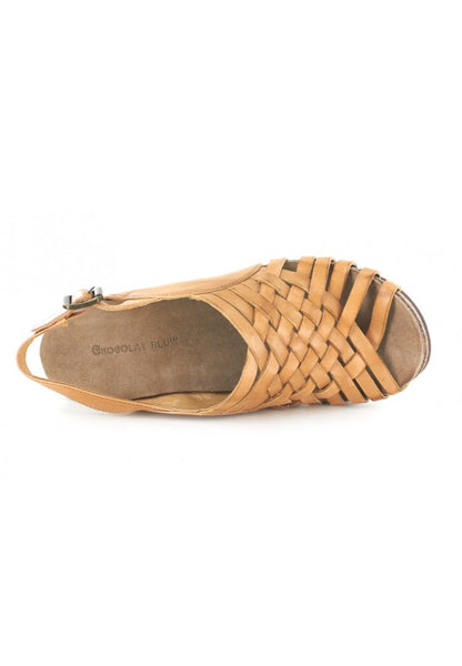 A gorgeous adjustable sling back sandal with a wedge heel, and a woven basket design made for comfort and the perfect picnic on a beautiful day out.