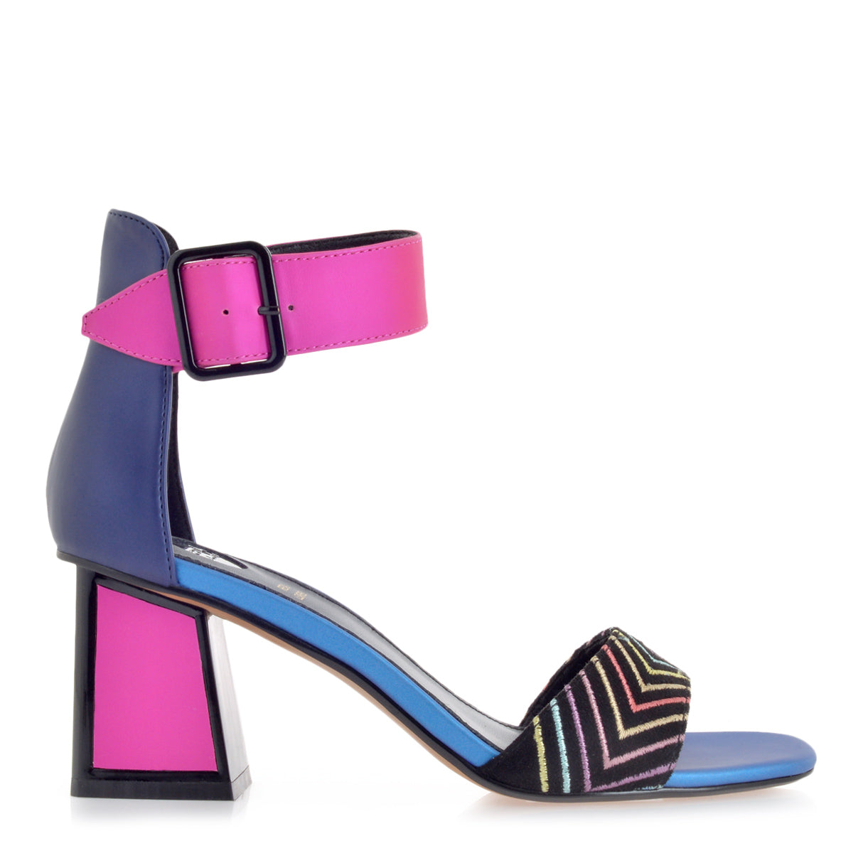 The Exe sandal features a pink geometric mid height block heel outlined in black with a rubber sole. The model is cut in a vapor wave colored fabric and decorated with a pink adjustable strap around the ankle and a strap over the foot with multi-colored arrow stripes.  Heel Height: 7 cm. At Shoe Be Do in New Orleans,la.
