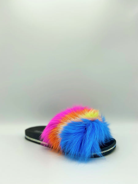 FLUFF & PUFF! Cape Robbins Sandal womens slide sandals are puffy, fluffy fun and so easy to wear, dressing up just about any outfit with tufts of bright feathers. This flat slide with a wide band at the front adds just the right amount of accent to liven up any outfit. In New Orleans at Nola Foot Candy.