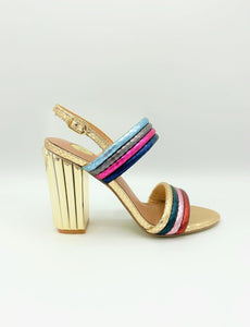 A Greek Doric column inspired heel, featuring fun , metallic, multi-colored, hrizontal straps. In New Orleans at Shoe Be Do.