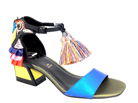 FUN IN THE TROPICS! A low sandal with a block heel, embellished with rhinestones and ruffles resembling a toucan, adorned with multi-colored pom poms.  In New Orleans at Nola Foot Candy.