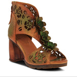 A Spring Step , French inspired, hand-painted leather closed back platform sandal featuring floral laser cutouts and matching leather flowers on the vamp. At Shoe Be Do in New Orleans,la