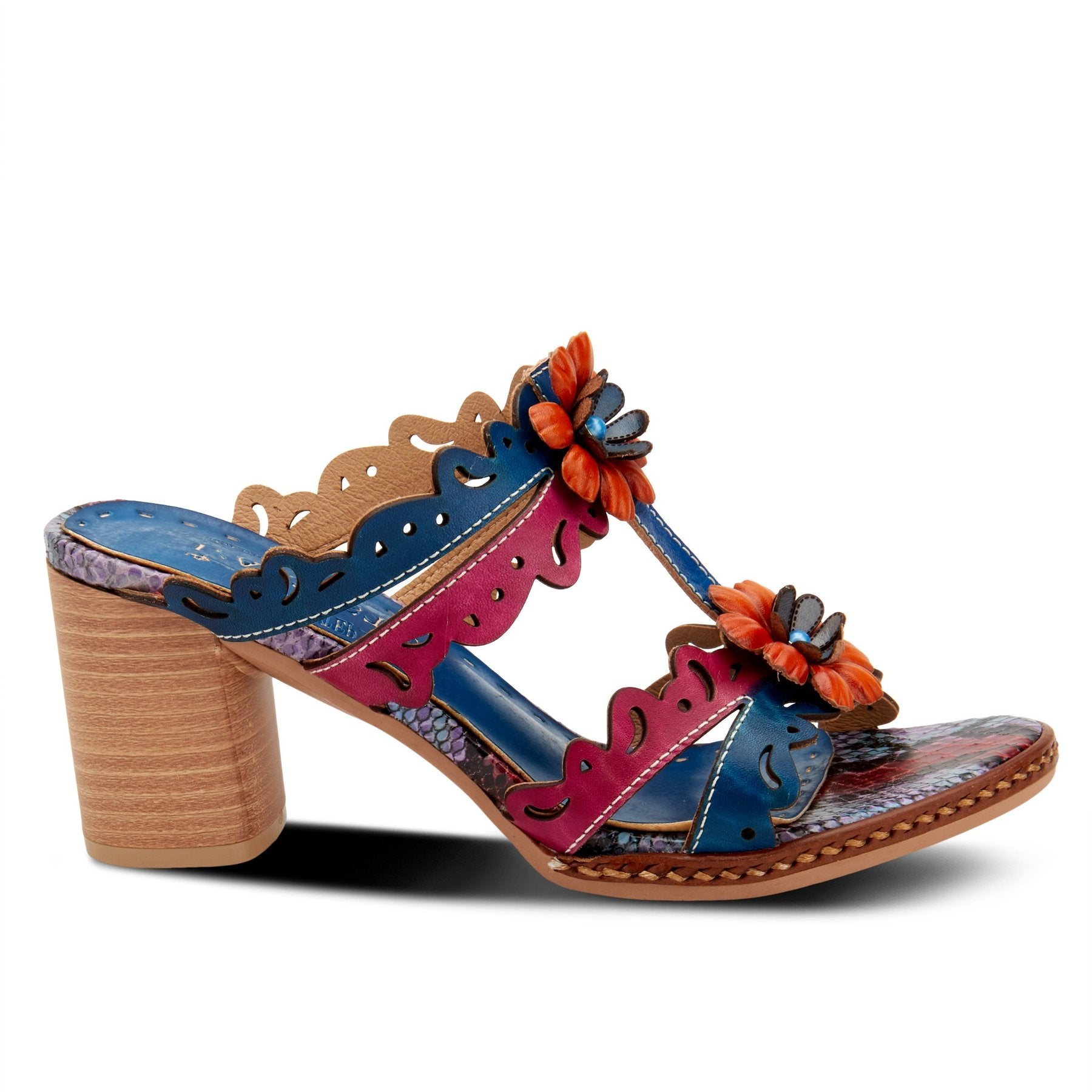 The beautiful hand-painted swirly die-cut leather straps in alternating colors feature laser cutout design with two dimensional brightly colored floral appliques centered with stones adorning the vamp.  A multi-color python print graces the toe bed and platform and the chunky heel keeps this artsy eclectic sandal comfortable for all day and night wear. In New Orleans at Nola Foot Candy.
