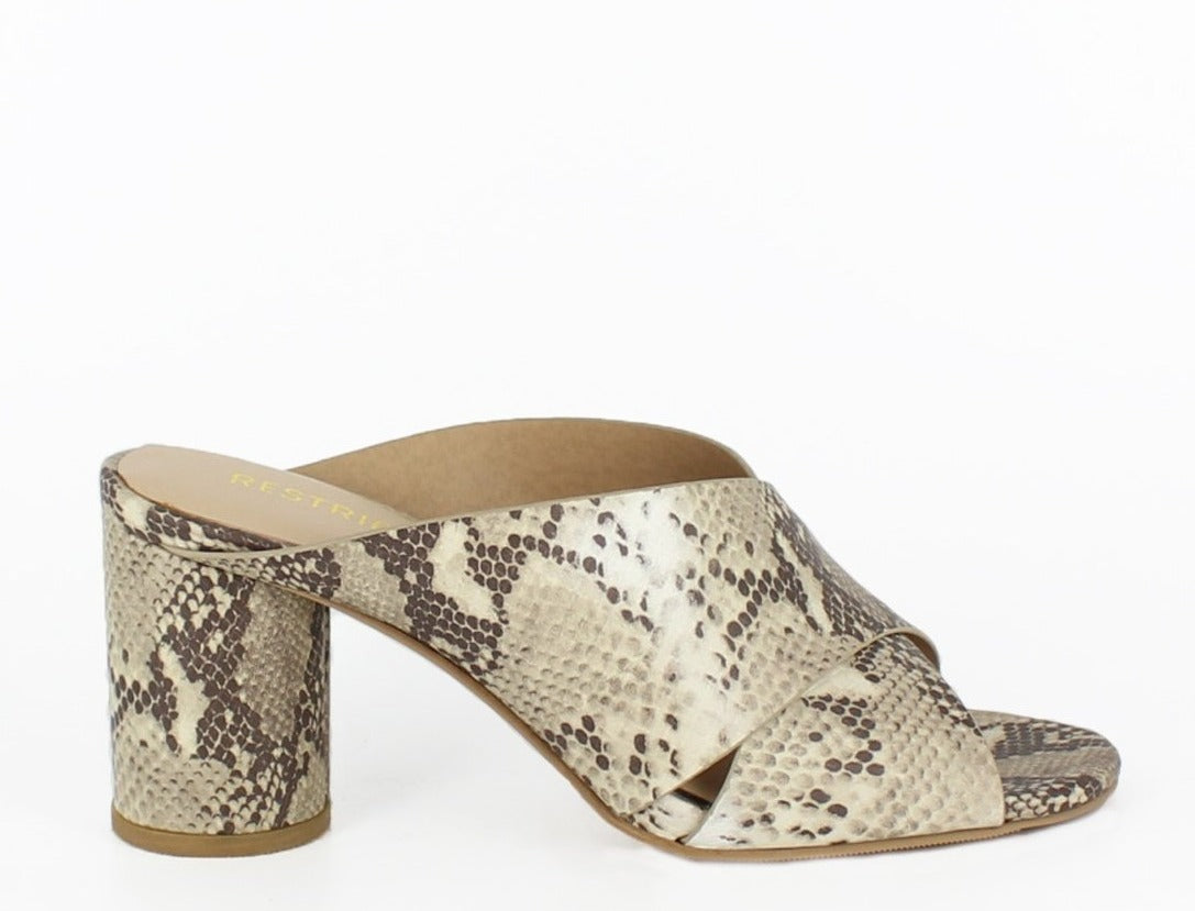 An open-toe, snake print, criss-cross mule with a cylindrical heel. At Shoe Be Do in New Orleans,la.
