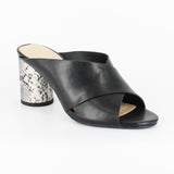 A black criss-cross mule with a snake print cylindrical 3inch heel. At Shoe Be Do in New Orleans,la.