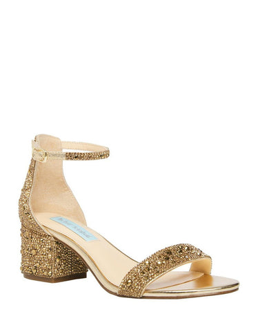 A stunning, simple gold sandal embellished with beautiful sparkling rhinestones and a satin veneer. These flirty open toe heels will leave everybody wanting more! In New Orleans at Shoe Be Do.