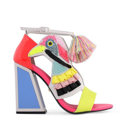 A multi-colored beaded bird finished with yellow, black, and pink frills, an adjustable ankle strap with multi-colored pom-pom detailing and grey patent-leather upper, a high blue block heel and a yellow toe strap. At Shoe Be Do in New Orleans,la.