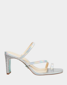 A strappy silver sandal featuring diagonal lines across the foot and a toe strap for a flawless effect, sitting on to of a wide stiletto heel. In New Orleans at Shoe Be Do.