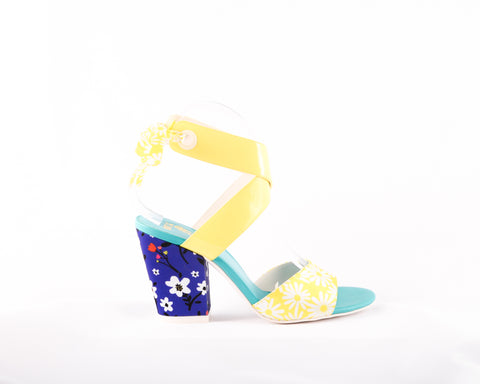 Feminine in floral! A cross strap mid heel with a ribbon closure, a floral print in yellow at the toe and a floral in blue on the heel. In New Orleans at Nola Foot Candy