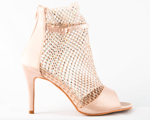A gorgeous satin champagne heel, a modern urban take on a elegant style. This open-toe heel features a mesh upper embellished in clear crystals.  In New Orleans at Shoe Be Do.