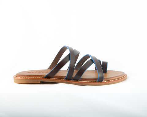A fun, strappy boho chic summer /spring sandal/slide. Featuring an interesting that works color pallet of brown, lined in blue.  In New Orleans at Shoe Be Do.