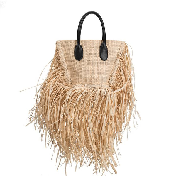 A tote woven of durable and sturdy straw, Maui features vegan leather top handles and a detachable and adjustable cross-body strap. Fully lined in cotton canvas. At Shoe Be Do in New Orleans,la.