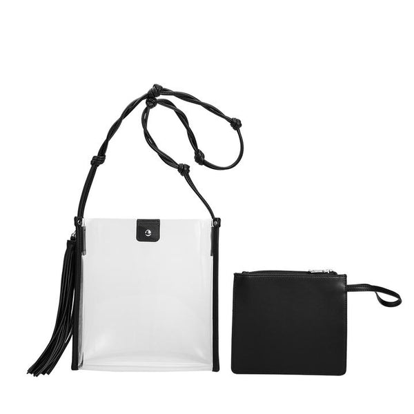 A clear cross-body with removable tassel and smaller zipper pouch. Featuring a twisted , knotted shoulder strap. In New Orleans,la at Shoe Be Do.