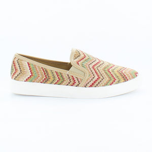 An easy, slip-on sneaker with tribal print over natural tones and white sneaker. In New Orleans at Nola Foot Candy.