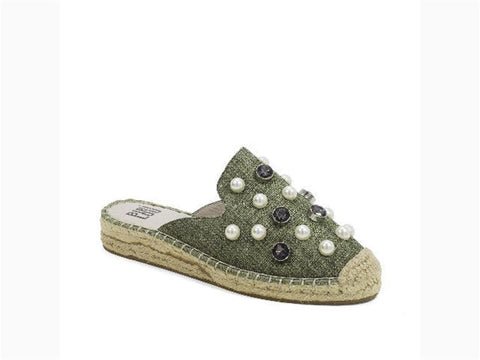 A casual, earth-toned, slide with a tom silhouette, sole wrapped in jute and reasonably covered in pearls and studded rhinestones. In New Orleans at Shoe Be do.