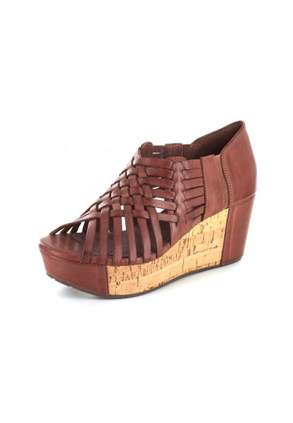 A super comfortable platform wedge sandal in the color Bourbon, made completely out of genuine leather and cork. Featuring intricate web detailing. At Shoe Be Do in New Orleans,la