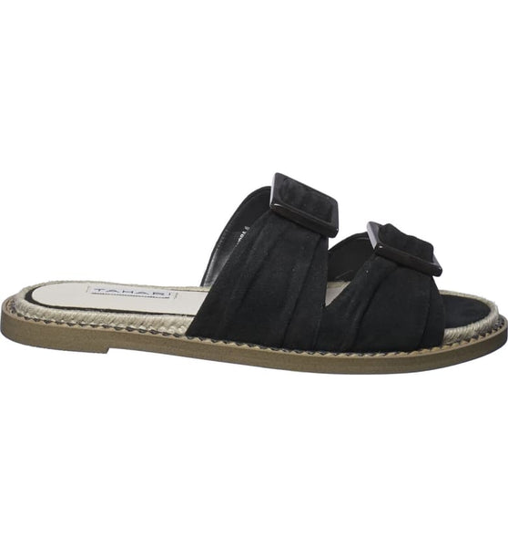 Square center buckles add a contemporary twist to this easy two-strap slide sandal. In New Orleans at Shoe Be Do.