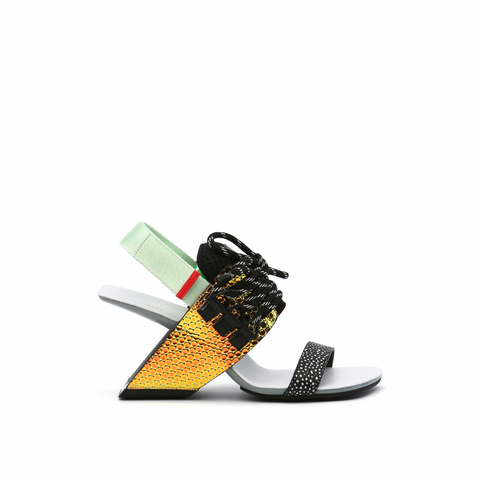 A sandal with  a United Nude signature heel and loop sport design. Featuring a lace-up upper resembling a trainer. A green/gold iridescent heel resembling reptilian scales, black and white toe strap, and mint Velcro sling back tipped in red. In New Orleans at Shoe Be Do.