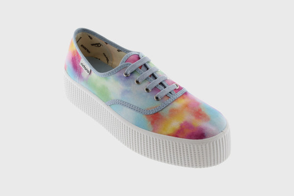 A colorful, tie-dye, platform, lace-up sneaker. In New Orleans at Shoe Be Do.