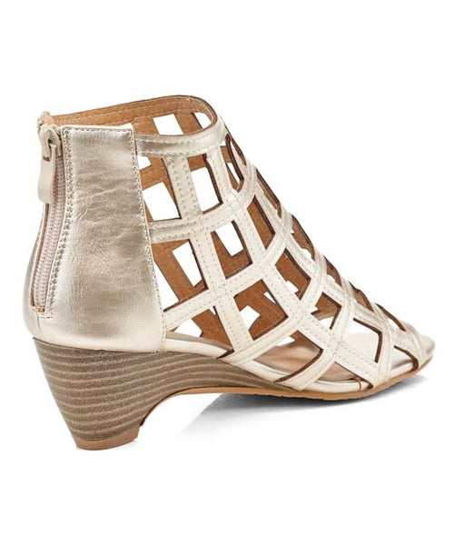 rame your pedi with these sandals that feature an intricate openwork design and a chunky stacked heel. A zip closure in the back lets you slip them on in a hurry. In New Orleans at Nola Foot Candy.