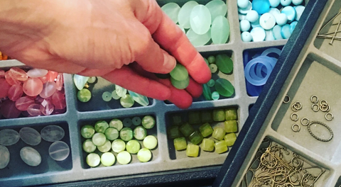 Hand picking out beads