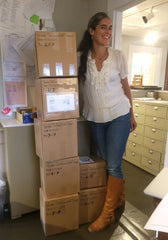 Stefanie Wolf with a stack of boxes of jewelry heading for UncommonGoods