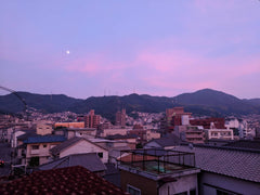 twilight makes purple sky over Kure after flooding