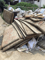 pile of ruined tatami straw mats after flood