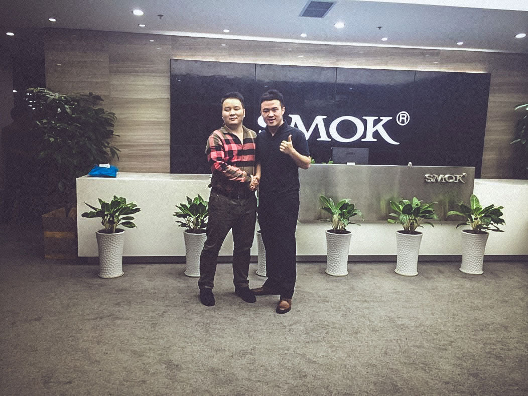 On left, Smok CEO Mr. Wei